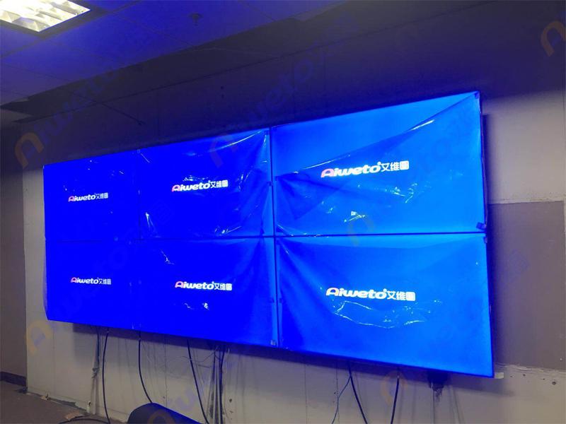 上海鼎信投资集团采用艾维图55寸2x3前维护3.5mm高清液晶拼接屏